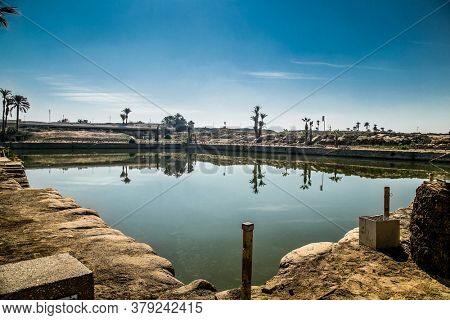 Pool in Luxor Temple in Luxor, ancient Thebes, Egypt. Luxor Temple is a large Ancient Egyptian temple complex located on the east bank of the Nile River.