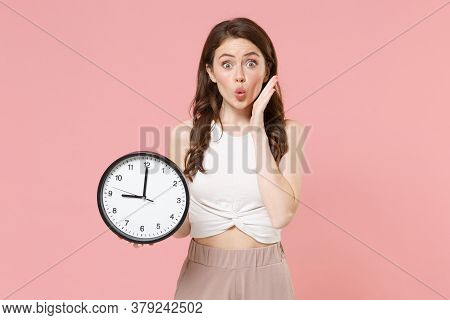 Amazed Young Brunette Woman Girl In Light Casual Clothes Posing Isolated On Pastel Pink Wall Backgro