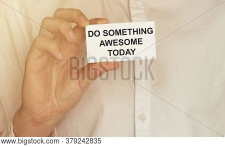 Man Take A Paper With Text Do Something Awesome Today On The Shirt
