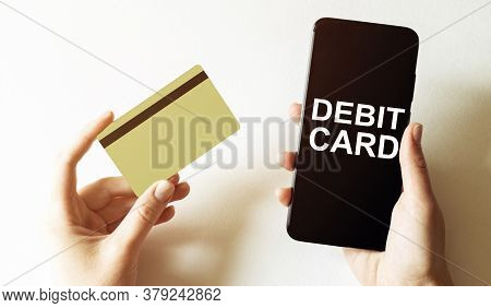Gold Card And Phone With Text Disaster Recover Plan Debit Card In The Female Hands