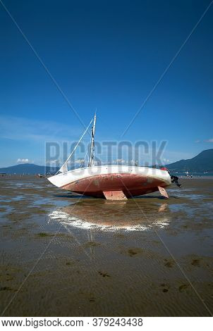 Beached Sailboat Spanish Banks Vancouver. A Beached Sailboat At Low Tide On Spanish Banks Beach Vanc