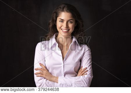 Attractive Young Woman Studio Shot While Standing At Isolated Black Background