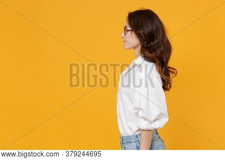 Side View Beautiful Young Brunette Business Woman In White Shirt Glasses Isolated On Yellow Backgrou