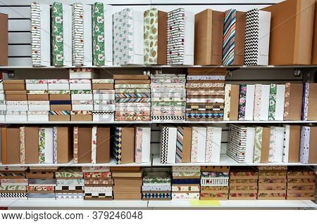 Gift Wrapping Boxes. Many Gift Boxes Of Different Shapes And Designs For Gift Wrapping On The Shelve