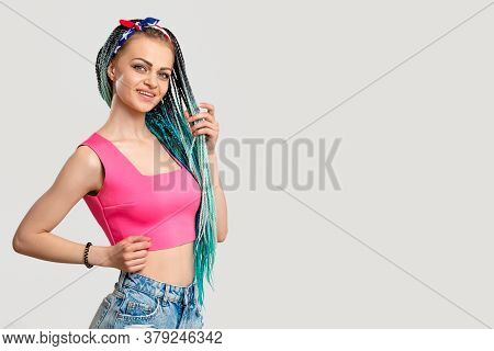 Woman With Blue Colored Hair Braids. Portrait Of Cheerful Enthusiastic Lady In Pink With Bright Dyed