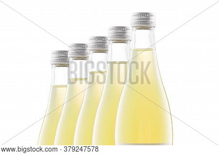 Transparent Bottles Of Yellow Lemonade Stand In A Row Behind Each Other. Isolate