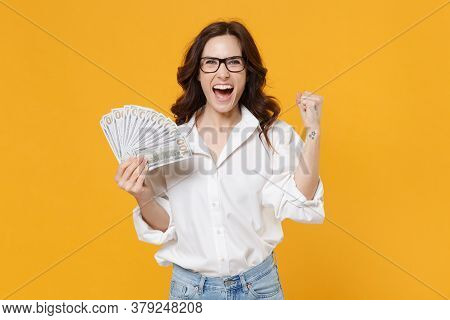 Happy Young Brunette Business Woman In White Shirt Glasses Isolated On Yellow Background. Achievemen