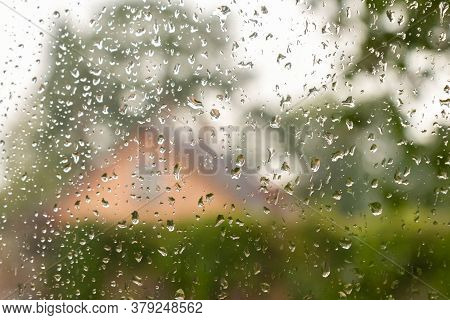 Water Drops On Window. Autumn Rural Landscape Through Raindrops On The Window Glass. Drops Of Rain O