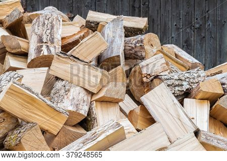 Dry Chopped Firewood Background. Preparation Of Firewood For Winter. Rural Cozy Firewood Backdrop. N