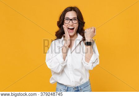 Excited Brunette Business Woman In White Shirt Glasses Isolated On Yellow Background. Achievement Ca