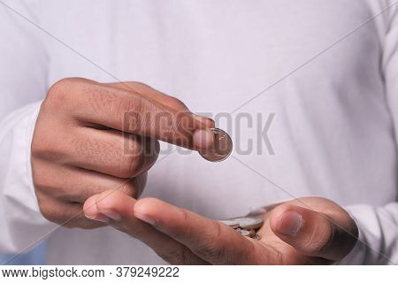 Close Up Of Man Hand Counting Coins