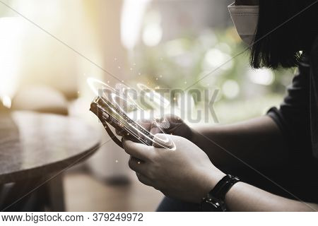 Woman Wear Surgical Face Mask And Input Security Password To Access To Smartphone. Security And Tech