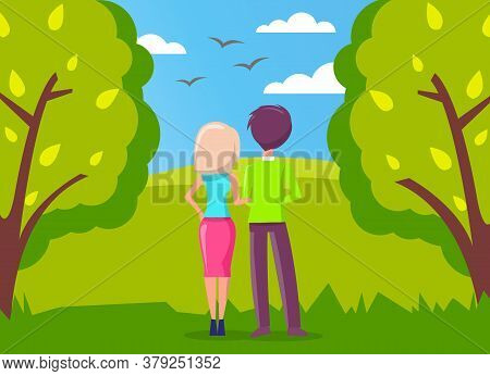 Man And Woman, Couple In Love Walking In Green City Park And Looking Far Away At Birds Flying In The