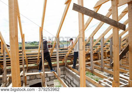 Fasteners And Installation Of Roof Rafters By Workers. Preparation For Laying Slate. Construction An
