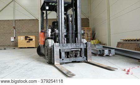 Car -old Forklift, Forklift, Stacker Truck, Warehouse Forklift. Old Car Under Repair In The Garage.