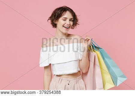 Smiling Funny Young Woman Girl In Summer Clothes Hold Package Bag With Purchases Isolated On Pastel