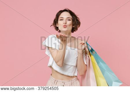 Pretty Young Woman Girl In Summer Clothes Hold Package Bag With Purchases Isolated On Pink Backgroun