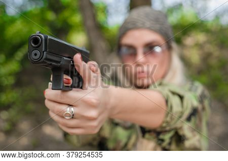 Attractive Woman Gun Point Aim To Attacker. Close-up Front View