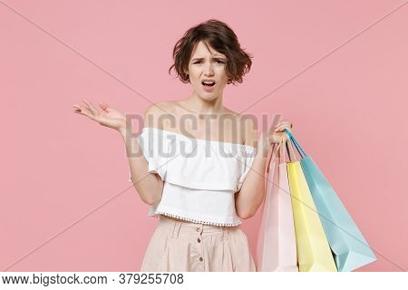 Displeased Perplexed Young Woman Girl In Summer Clothes Hold Package Bag With Purchases Isolated On