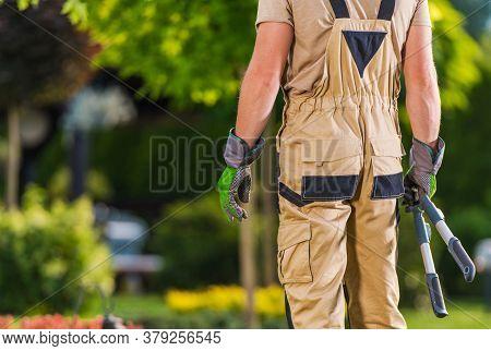 Caucasian Gardener In His 40s With Large Scissors Gardening Tool In His Hands Inside Large Beautiful