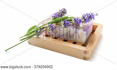Natural Homemade Lavender Soap With Lavender Flowers On Wooden Soap Dish On White Background.