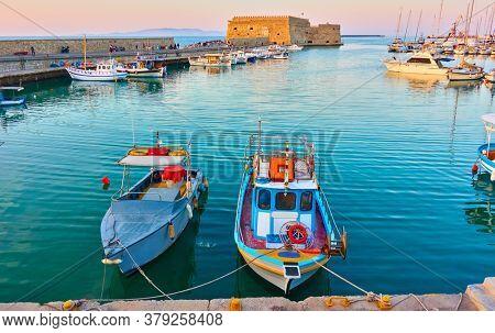 Fishing boats in the harbour near the Venetian Fortress in Heraklion, Crete, Greece