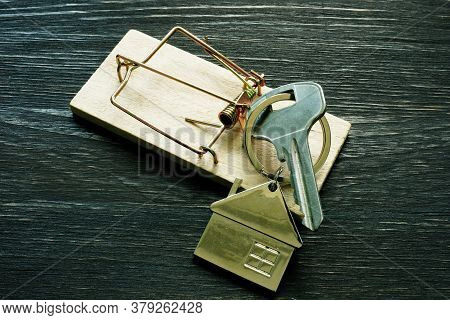 Mousetrap And House Keys. Mortgage Fraud Home Buying Scam.
