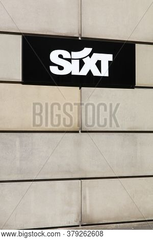 Aarhus, Denmark - August 25, 2019: Sixt Logo On A Wall. Sixt Is A European Multinational Car Rental