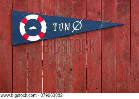 Tuno Island Sign In Denmark On A Wooden Wall