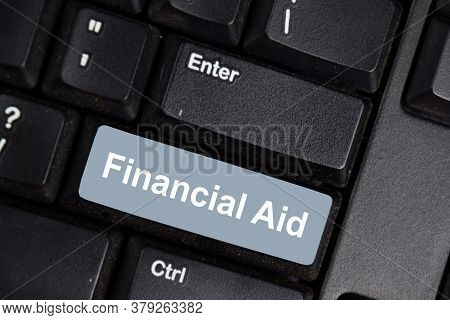 Financial Aid Write On Keyboard Isolated On Laptop Background