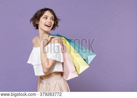 Side View Of Cheerful Young Woman Girl In Summer Clothes Hold Package Bag With Purchases Isolated On