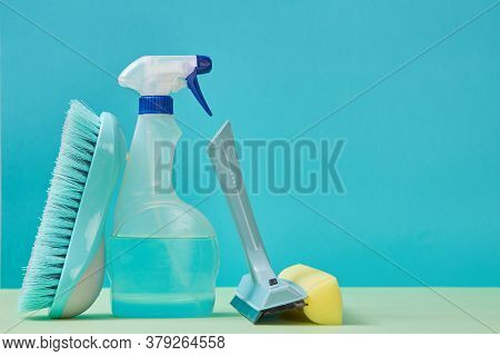 Housekeeping. Cleanup. Cleaning Supplies Concept. Detergent Spray And Brush. Nozzle For Washing Wind