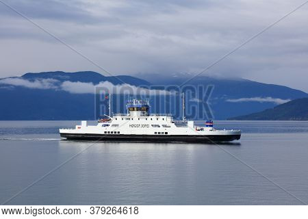 Sognefjord, Norway - July 30, 2020: Passenger And Car Ferry Crosses Sognefjord In Norway. Public Tra