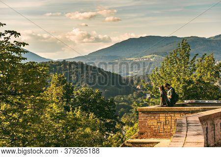 Graz, Austria - 13.07.2020: Couple At Schlossberg Hill In Graz Enjoying The View At Mountains