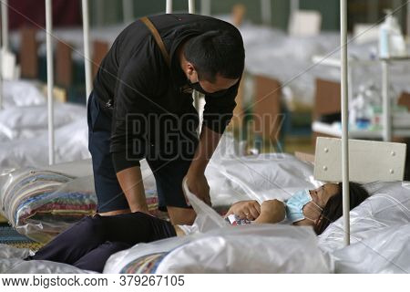 A Patients Get Help In The Temporary Covid-19 Care Center In Bishkek, On Jule 5, 2020. The Temporary