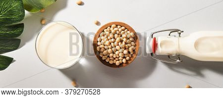 Soy Milk And Soy Bean On Gray Table Kitchen Background. Non-dairy Milk Concept. Vegan Drink. Panoram