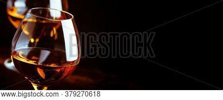 Grape Brandy In Shot Glass, Dark Brown Background. Panoramic Banner With Copy Space