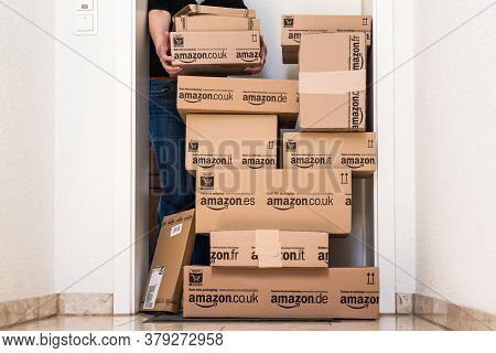 Ostfildern-scharnhausen, Germany - May 18, 2014: A Woman Is Picking Up A Large Stack Of Parcels By A
