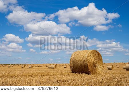 Hay Bales On The Field After Harvest. Beautiful Countryside Landscape, Rural Nature In The Farm Land