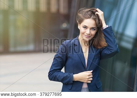 Portrait Of Beautiful Young European Businesswoman Or Student In Formal Suit Standing Outdoors. Gorg