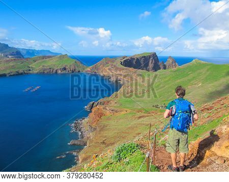 Solo Male Backpacker Hiking In Madeira, Portugal. Active Healthy Lifestyle.majestic View Of Wild Bea