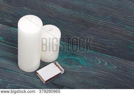 Two Large White Candles. Between Them Is A Box Of Matches. Love And Togetherness Objects. On Painted
