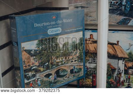 Broadway, Uk - July 07, 2020: Gibsons Puzzles On Sale In A Window Of A Shop In Broadway, A Large His