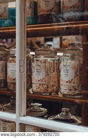 Broadway, Uk - July 07, 2020: Hamiltons Retro Sweets In Jars In A Window Of A Shop In Broadway, A La