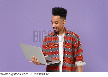 Smiling Young African American Guy In Casual Colorful Shirt Posing Isolated On Violet Background Stu