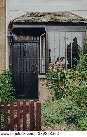 Broadway, Uk - July 07, 2020: Front Door And Bay Window Of A House In Broadway, A Large Village And