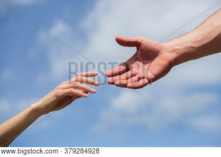 Hands Of Man And Woman Reaching To Each Other, Support. Giving A Helping Hand. Hands Of Man And Woma