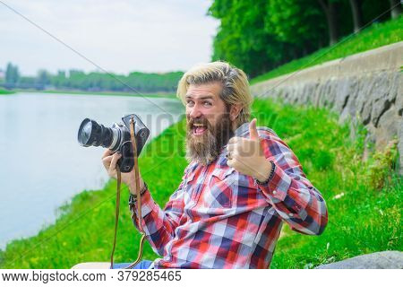 Bearded Man Taking Photographs. Hobby And Travel. Young Man Taking Photo With His Camera On Street.