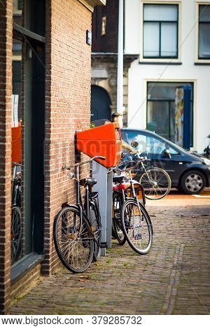Leiden, Netherlands, 31 July 2020: Image Of The Orange Mailbox Owned By The Post Nl, Holland Post Se