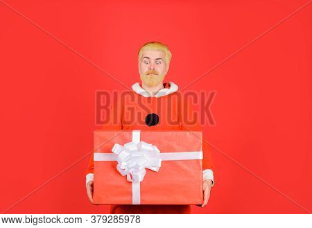 Happy New Year. Delivery Service. Santa Claus With Big Present Box. Bearded Man In Santa Costume Wit